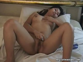 Asian sex addict shows off her masturbation style