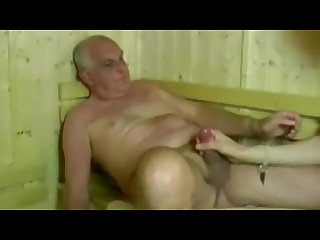 Grandpa and boy play in sauna