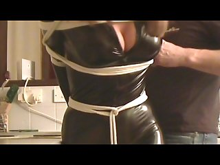 Holly beau caught tied in skin tight pvc catsuit