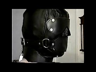 Properly kept in leather hood and armbinder
