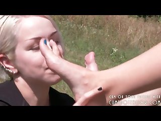 Young submissive teen licking feet