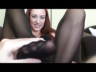 Hot footjob from young redhead cum on stockings