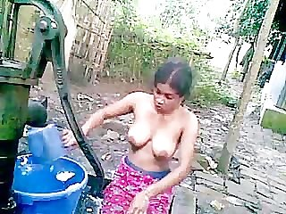 Bangladeshi deshi girl bathing outdoor and recording