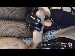 Handjoy handjob with black leather gloves while showing feet and ass