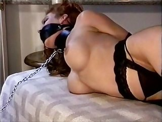 Strict tied and gagged chained on bed
