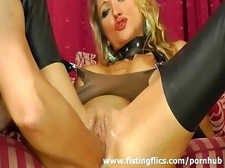 Busty blond milf enjoys a hard fisting orgasm