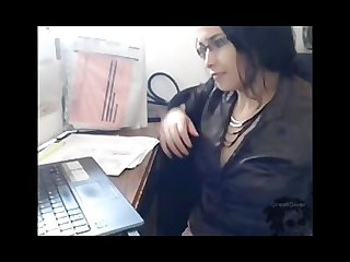 At work with a dildo up her ass