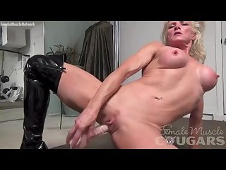 Muscular cougar mandy foxx is masturbating in shiny thigh high boots
