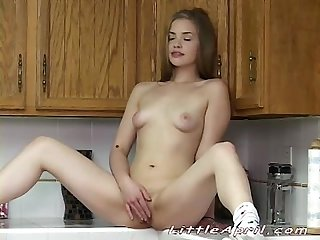 Little April fingering her pussy in the kitchen