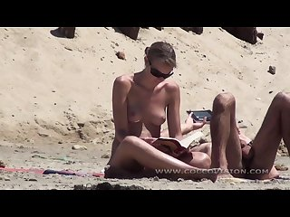 Nudist couple suntanning