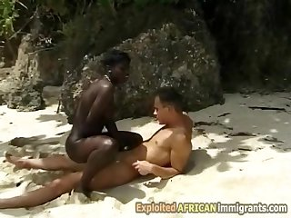 Hot hairy African girl pounded by big white dick outdoors on the beach