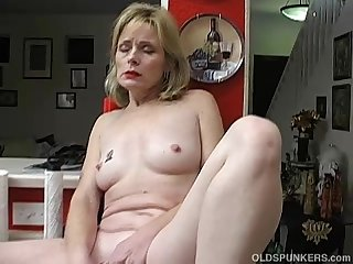 Super sexy older lady in red plays with her wet pussy
