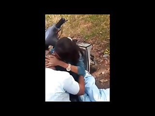 Indian friends hanging out and young girl kisses her boyfriend passionately