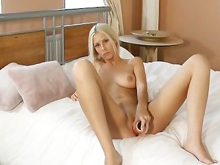 Teeny blonde chick with dildo