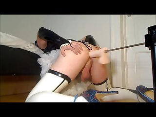 Sissy crossdresser maid in uniform and latex uses fucking machine