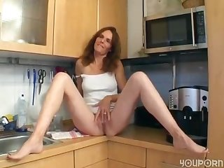 Horny german step mom in her kitchen