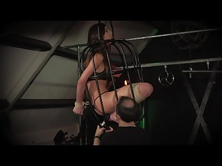 Teen trapped in a cage submissive to punishment and humiliation
