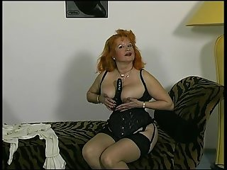 Red headed german granny shows off for the camera
