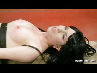 Pretty naked brunette slave gets her pussy spanked and teased