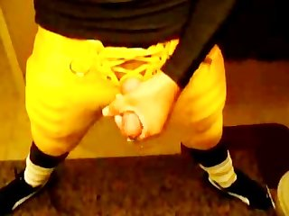 Football player jack off in uniform