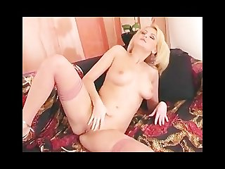 Blonde fingers her shaved pussy