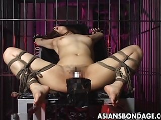 Sexy girl is tied up and fucked by big machine