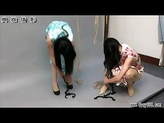 Two cute Chinese girls bound in tradional dresses