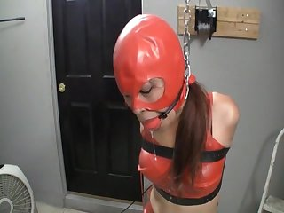 Sexy asiana tied and Ballgagged in red latex top and skirt