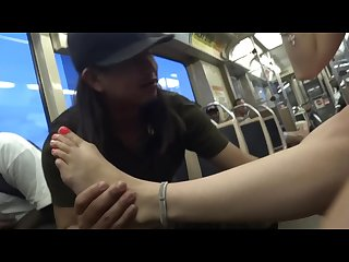 Drunk chick have her toes sucked on subway
