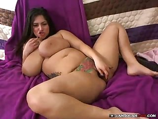 Chubby latina milf with tattoo on her little pussy