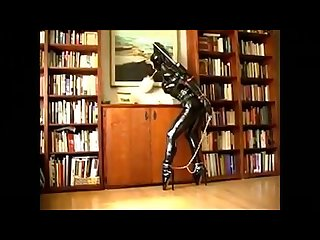 Latex catsuit and ballet boots