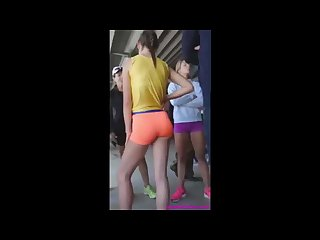 Candid teen track girl in orange shorts with incredible ass