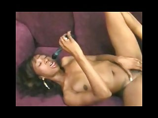 Sexy ebony uses blue toy in her wet black cunt