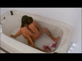 Couple having sex in the bathtub