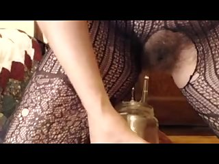 My hairy pussy pissing through fishnets