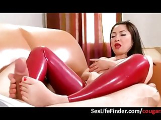 Asian cougar gives hot footjob