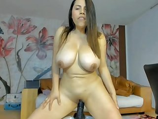 Busty bitch riding a dildo and squirting
