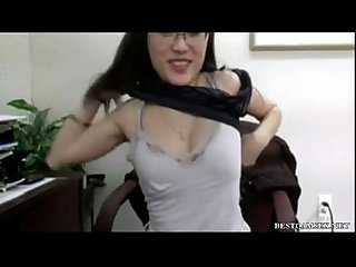 Asian girl masturbates in the office