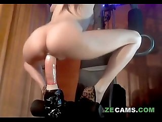 Skinny blonde riding dildo while make fitness