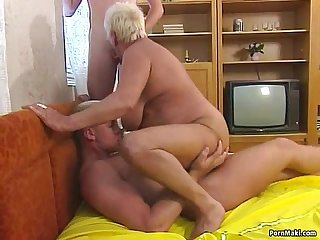 Busty blonde granny enjoys threesome fucking