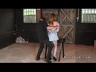 Bent over redhead slave gets spanked