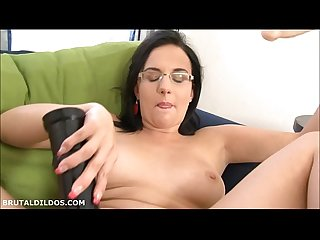Chubby secretary slut fills her pussy with a brutal dildo