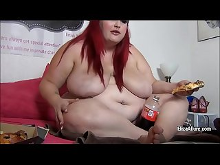 Bbw eliza allure sits on the bed and stuffs herself with big Pizza