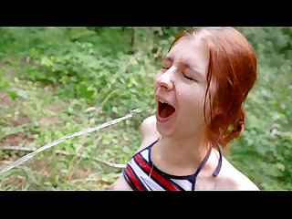 Redhead caught in park enjoys piss and public fuck
