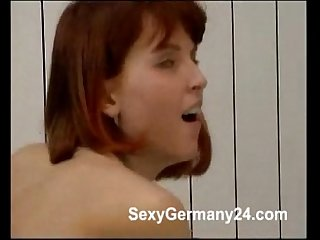 Cute mature couple has passionate sex in the bathroom