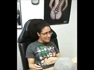 Nerdy brunette gets a clitoris piercing and sucks cock