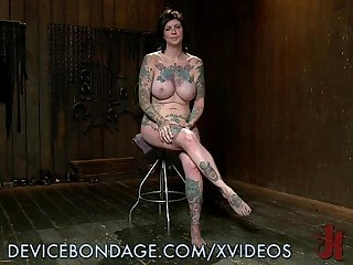 Tattooed busty babe punished