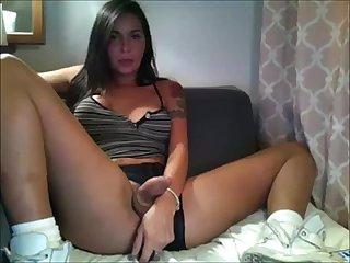 Cute and young shemale brunette on cam