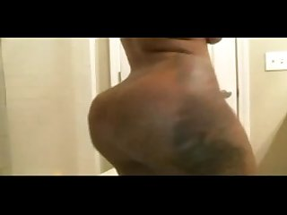Mega black booty with tattoos takes a shower