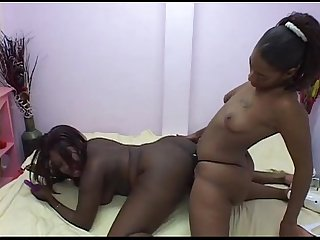 ebony lesbian enjoying hot strapon